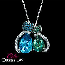 rainforest and paraiba blue Swarovski topaz with brilliant white topaz tails Kitties pendant