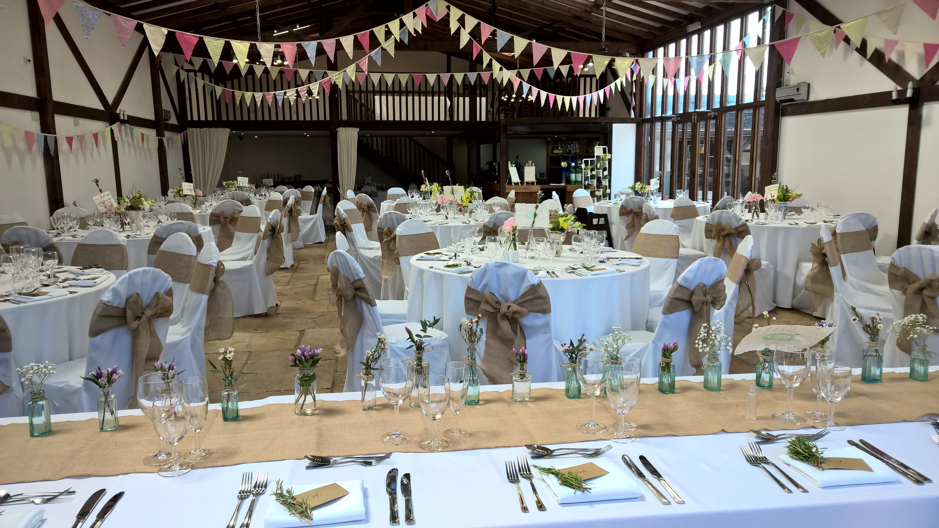 Natural Hessian Sashs Added To Our White Chair Covers Ceiling Bunting To Really Fin Vintage Wedding Decorations Barn Wedding Decorations Natural Wedding Decor