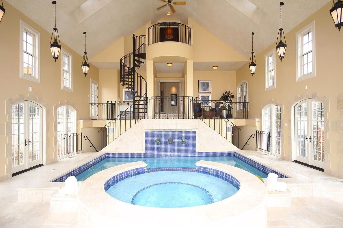 Gorgeous Residential Indoor Pool Interior Design With Round And Rectangular  Shaped Pools And White Ceramic Floor Tile And Brown Wall Paint Color Also  ...