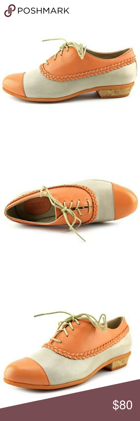 """Wolverine Tangerine & Stone Colored Leather Oxford Every girl needs an Oxford (at least one) in their closet to throw on with your everyday classic outfit - a pair of jeans and a T topped with a blazer. But what every girl doesn't have is a special pair that will stand out and take the basic outfit to a noticeable one.  Tangerine and stone contrast color make it great for summer. The wolverine brand has been designing shoes since the 1880's making it truly a classic Leather upper Cap toe 1""""…"""