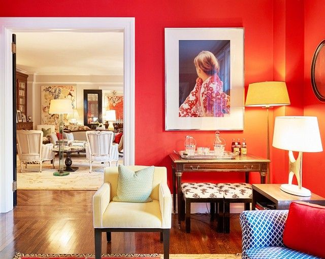 Bright red room with a yellow armchair and an eclectic bar table