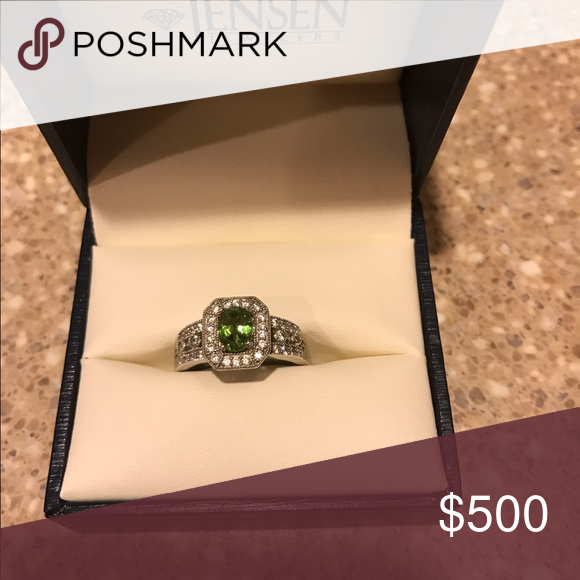 Alexandrite and diamond ring. Size 7 1/2 color changing Alexandrite and Diamond ring. Changes color from green to pink depending on the light. Jewelry Rings