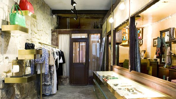 Paul Smith's Paris shop embraces years of wear and decay. Lovely.