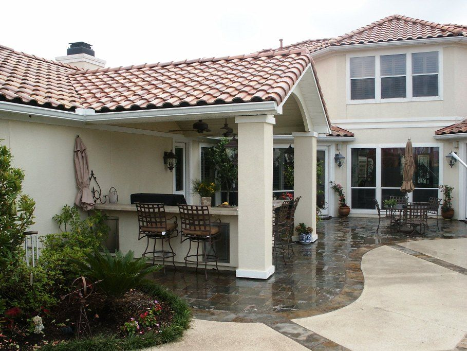 Custom designed and built gable tile roof addition with for Stucco columns
