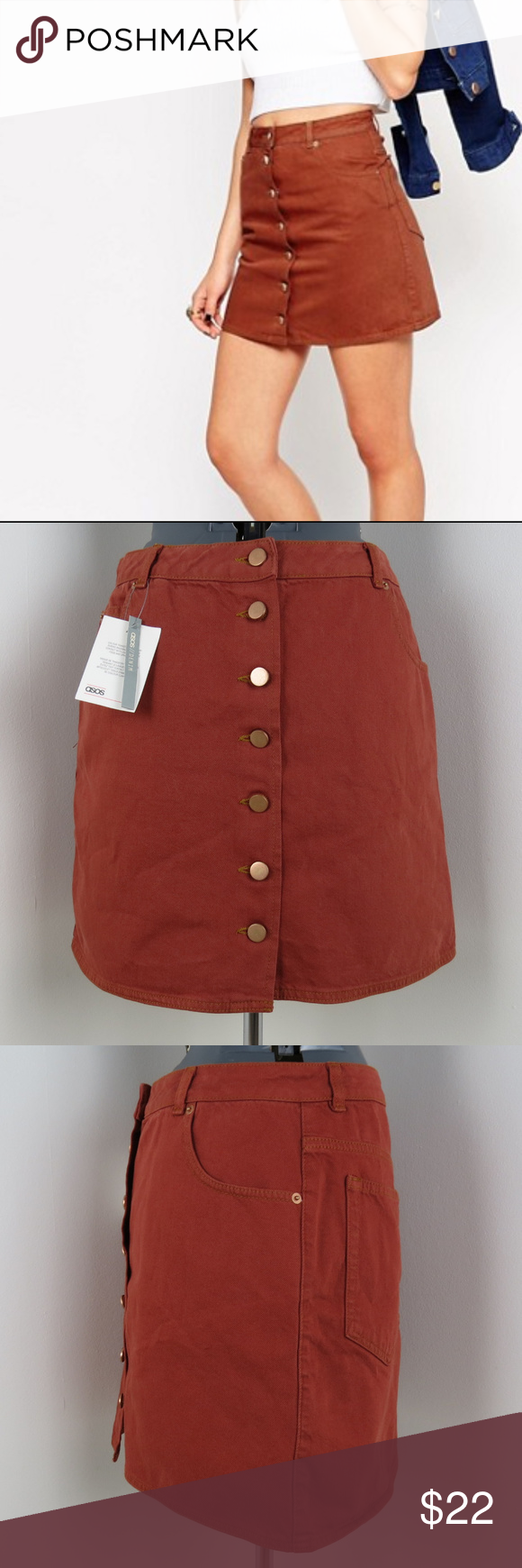 6d1dd01a8 NWT ASOS | Rust Denim Dolly Button Skirt (A4) NWT rust red denim mini skirt  with 7 copper color buttons down the front by ASOS Denim. 100% Cotton.