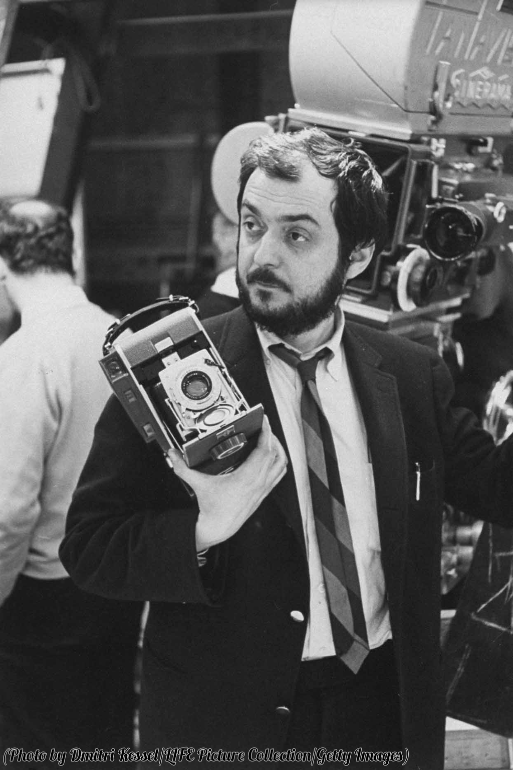 Stanley Kubrick holding a polaroid camera during the filming of 2001: A Space Odyssey, 1966.