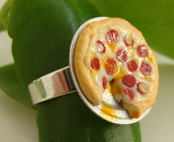 On your finger.   21 Ways To Wear Pizza With Pride