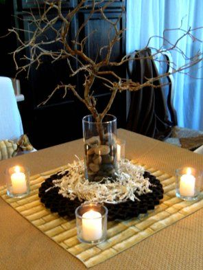 Pinned for the idea of tree branch centrepieces, dark, with led candles hanging from them in holders. Put table names and hang from lower branches.