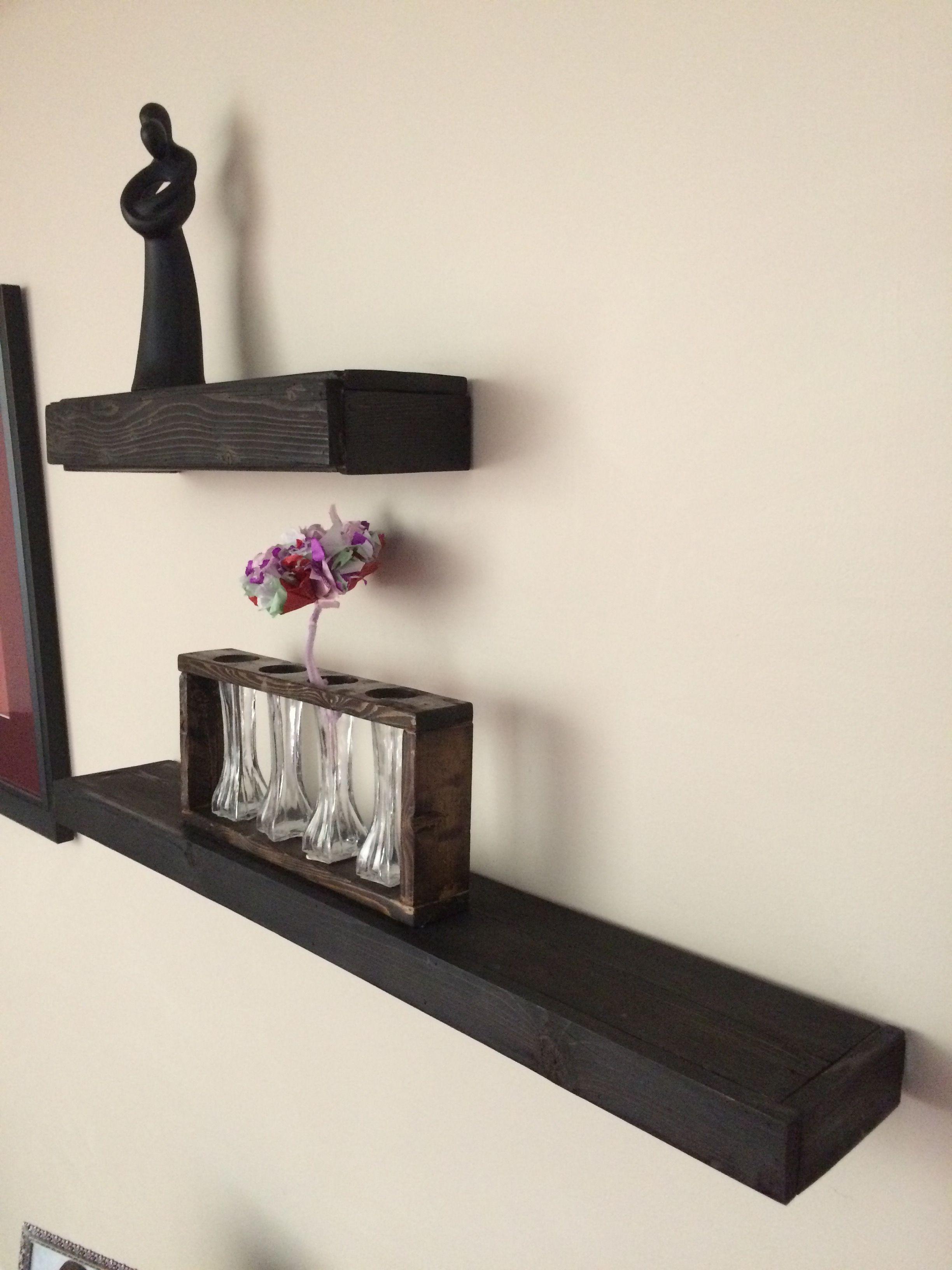 Custom made Barnwood floating shelves stained black