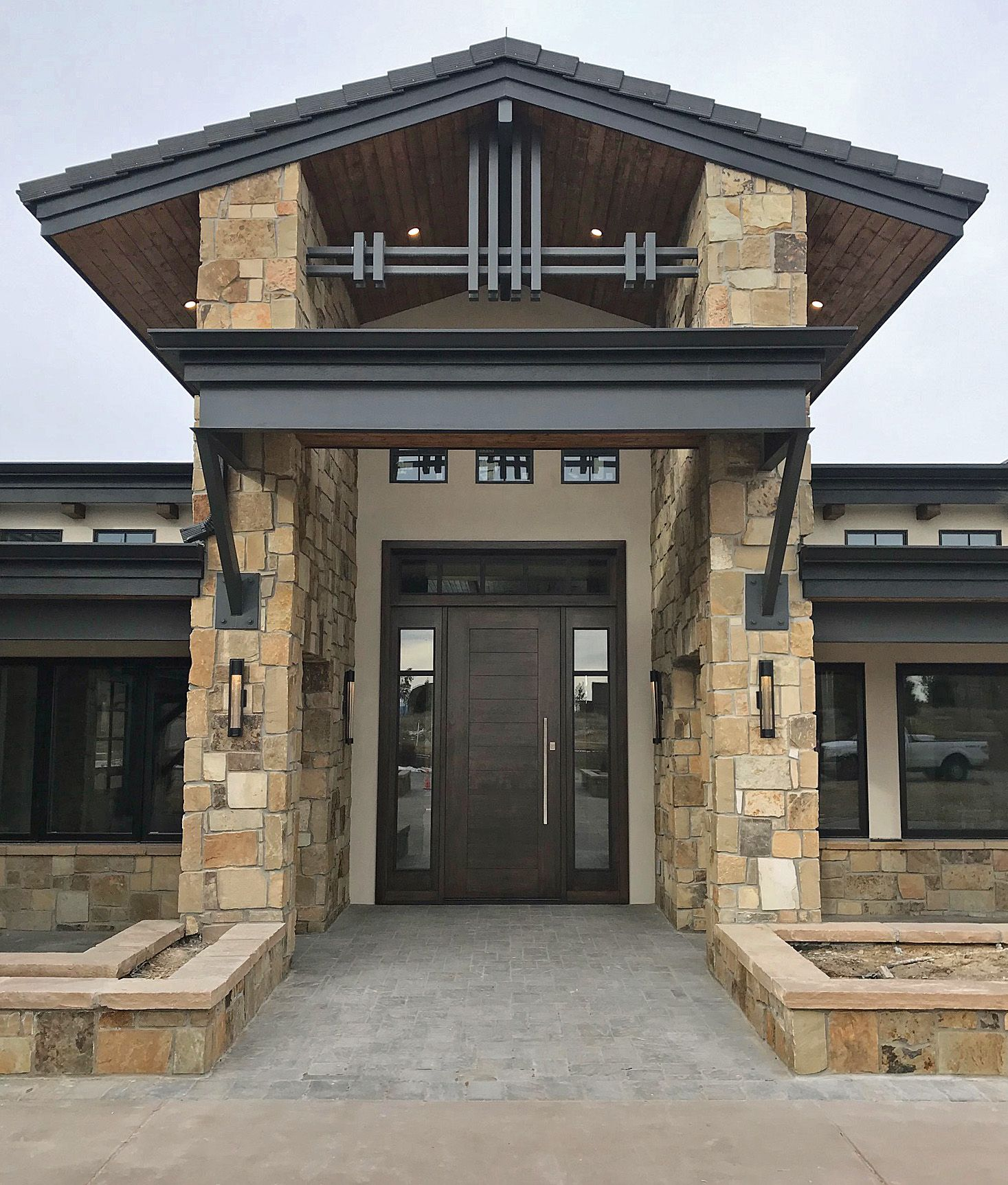 With All The Interesting Details And Large Scale This New Home S Entrance Makes A Dramatic Statement The Door Alone House Entrance Grand Entrance New Homes