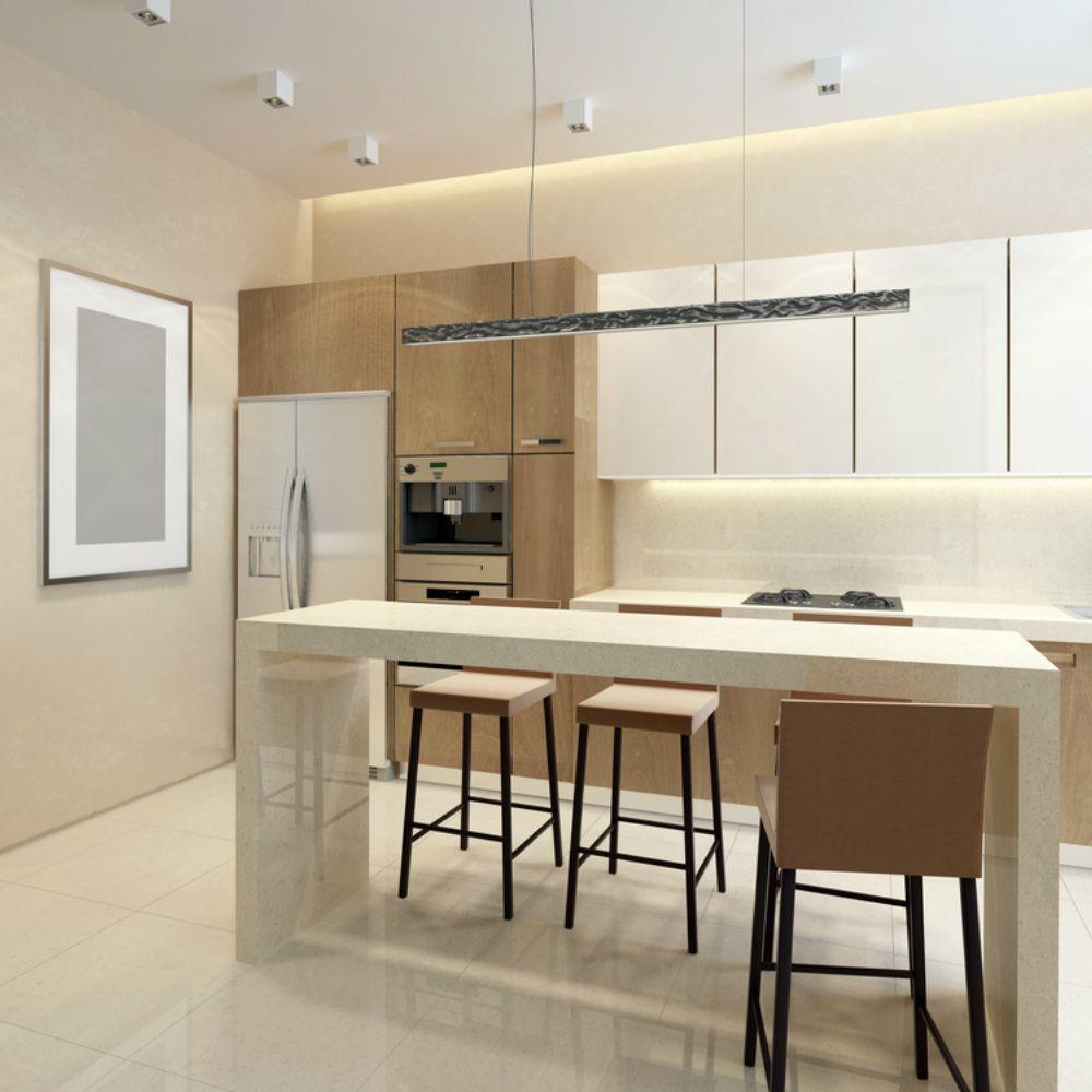 Una cucina da sogno con lampade di design e barre led su ...