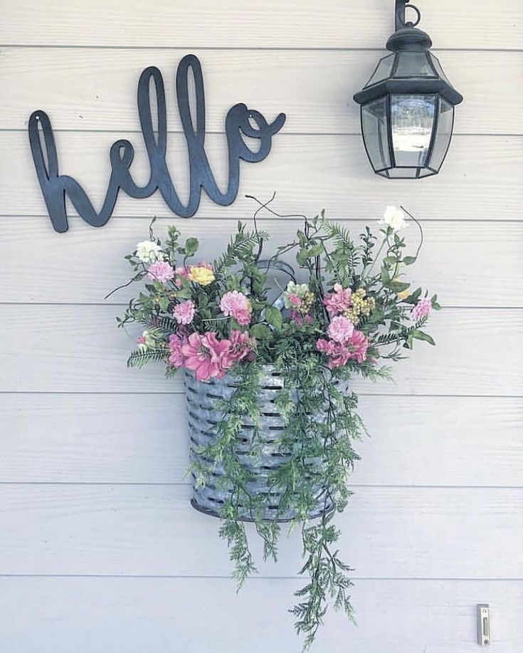 Rustic farmhouse style home decor. Hello sign and flowers.