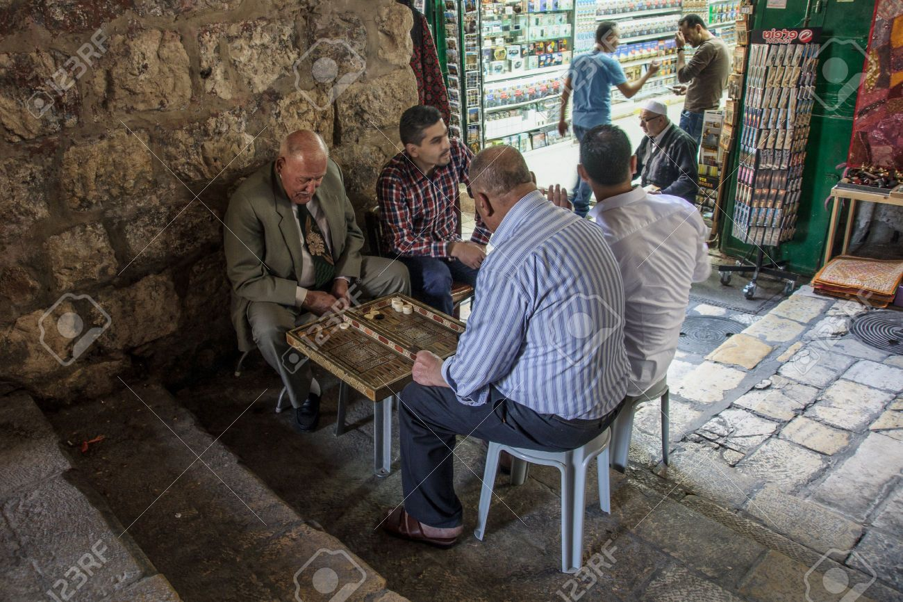 Typical-street-scene-of-backgammon-players-in-the-old-city-of-Jerusalem-Isra-Stock-Photo