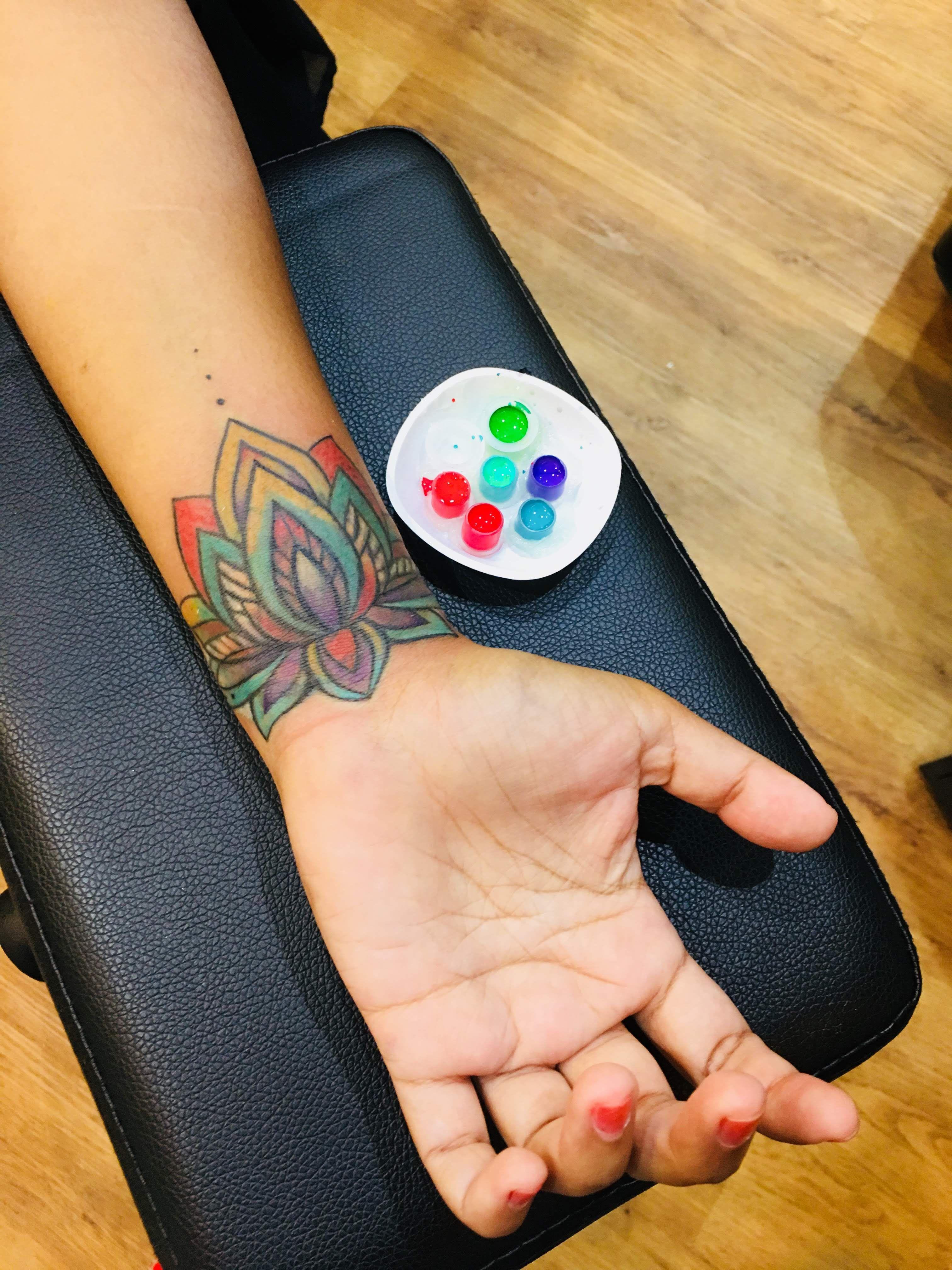 Rainbow Coloured Lotus Tattoo Tattoo Artist Sumithra Debi Johnny Two Thumb Pte Ltd The Original Johnny Tw Sugar Skull Tattoos Body Art Tattoos Thumb Tattoos