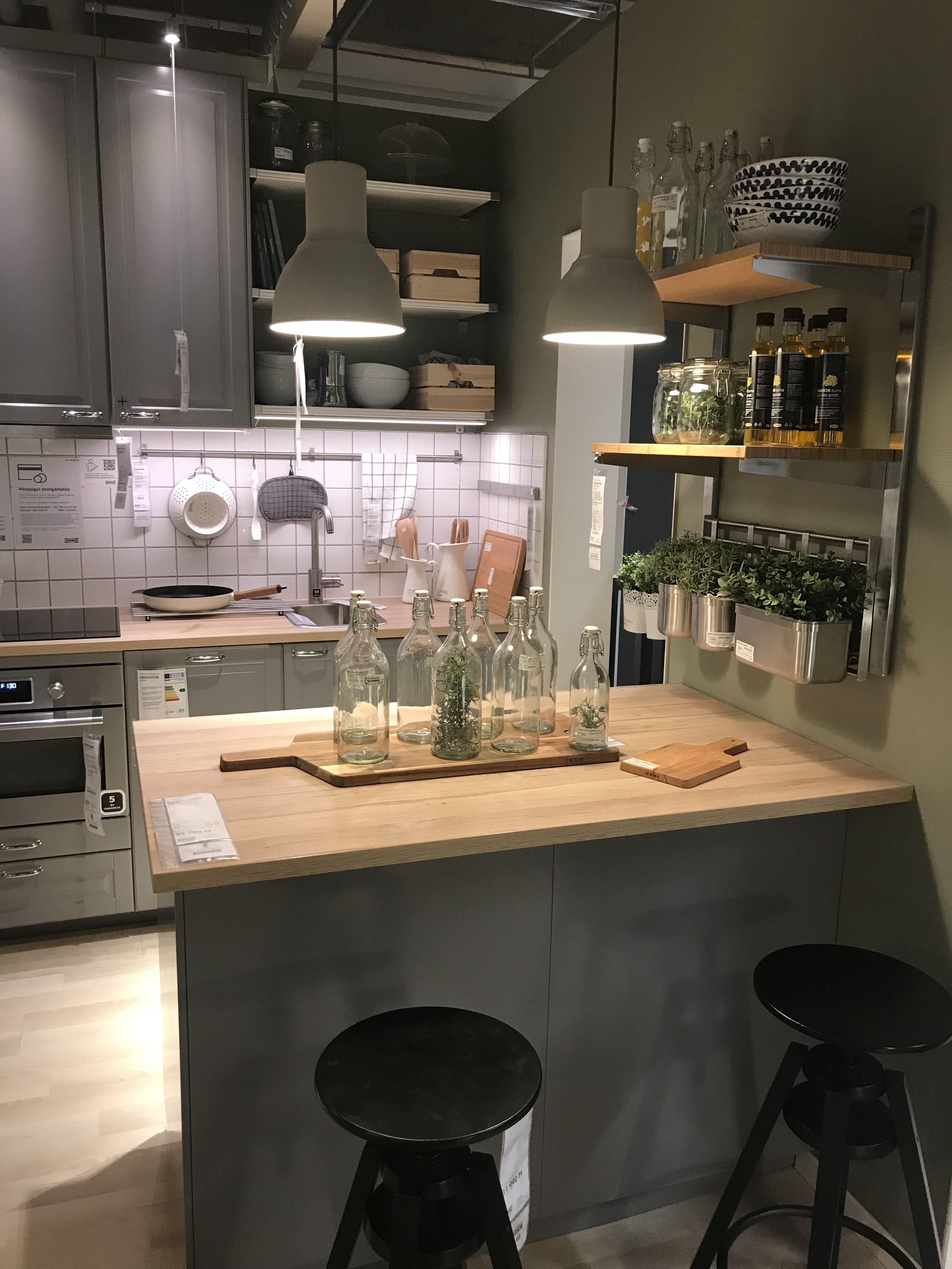 Grey kitchen with wood and olive green walls