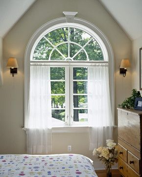 Traditional Bedroom Design With Enchanting Arch Windows Also Lovely White Transpa Curtains And Clic Wall Lights Light Brown Paint