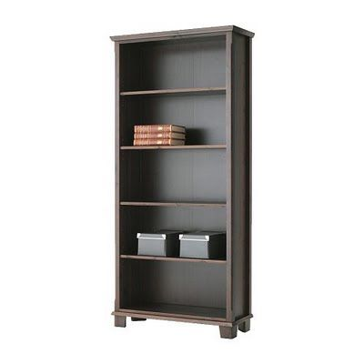 2 Brown Ikea Markor bookcases - one on each side of the entryway ...