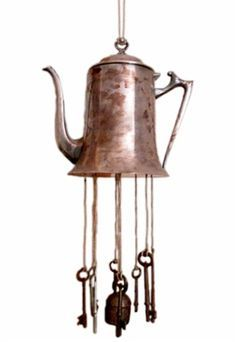 I'm not crazy about the rusted look on the teapot, but the keys make me think of the winged keys in Sorceror's Stone. v. appropriate decor for us.