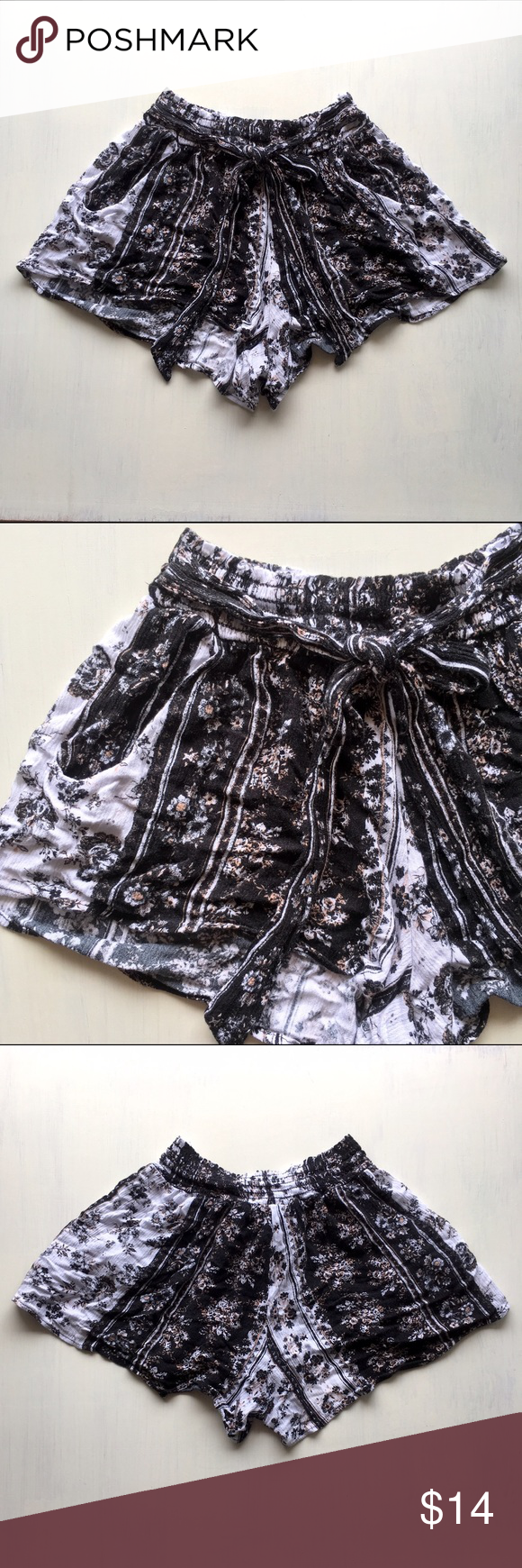 Light Flowy Smocked High Waist Floral Shorts w Tie Floral Black White Lightweight Soft Flowy Smocked Floral Short Shorts with decorative Tie in front. Can be high-waist or low. Comfortable pull-on-and-go shorts. Says Large, but fit like a MEDIUM. Lightly used, good condition. JW Girl Shorts