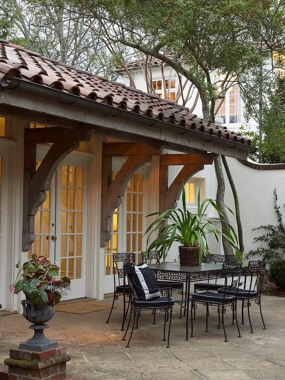 A Wall Of Transom Windows And French Doors Open To A Patio