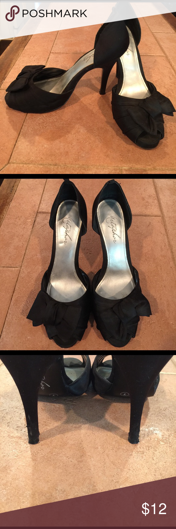 Black heels Peep toes with bow detail, slight scuff on heels and moderate wear on bottoms. Metaphor Shoes Heels