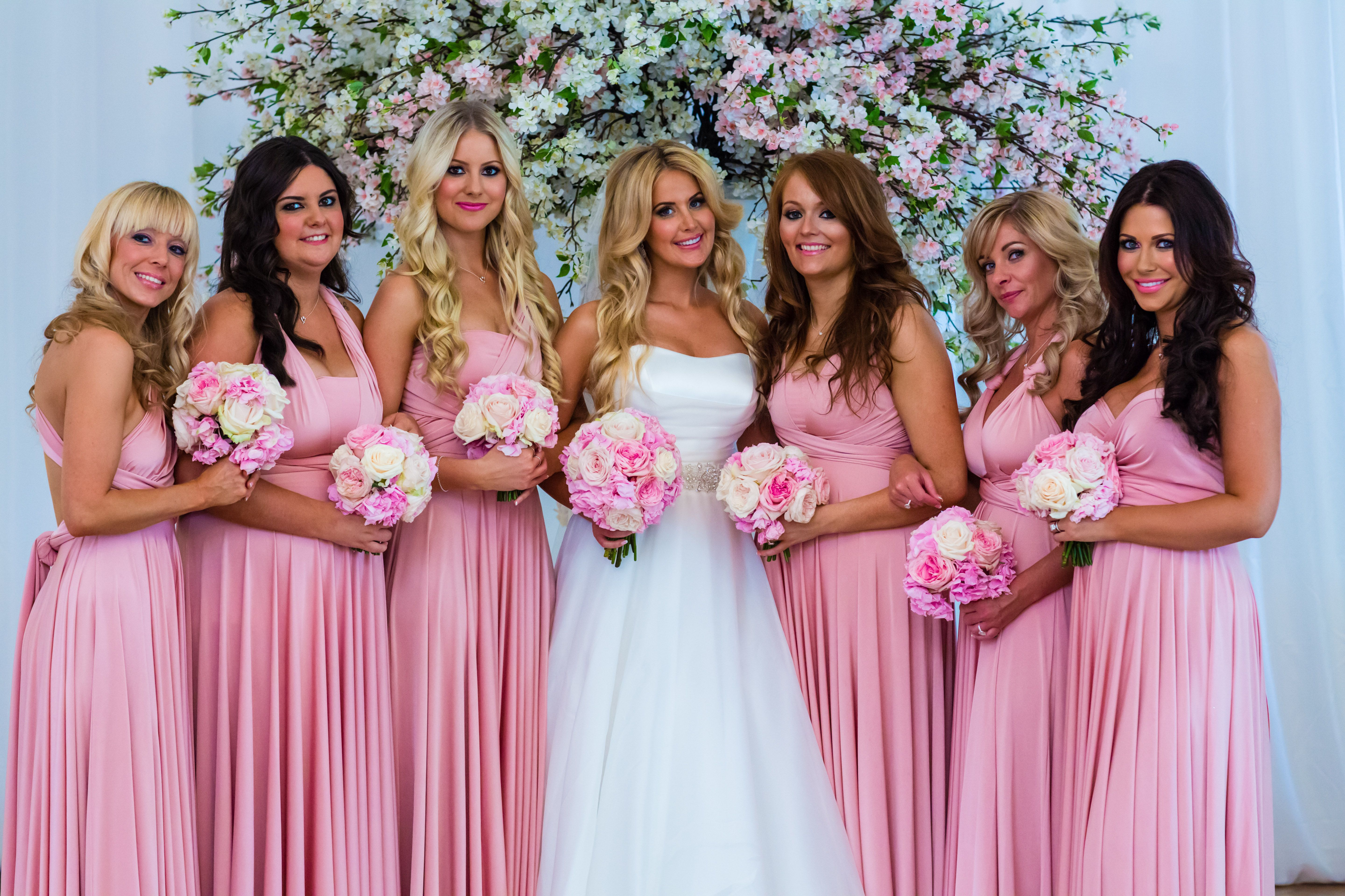 The beautiful bride with her bridesmaids in blush pink two birds ...