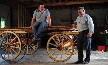 Making a wooden carriage wheel, at Mike Rowland Wheelwright and coachbuilders, in Colyton, Devon