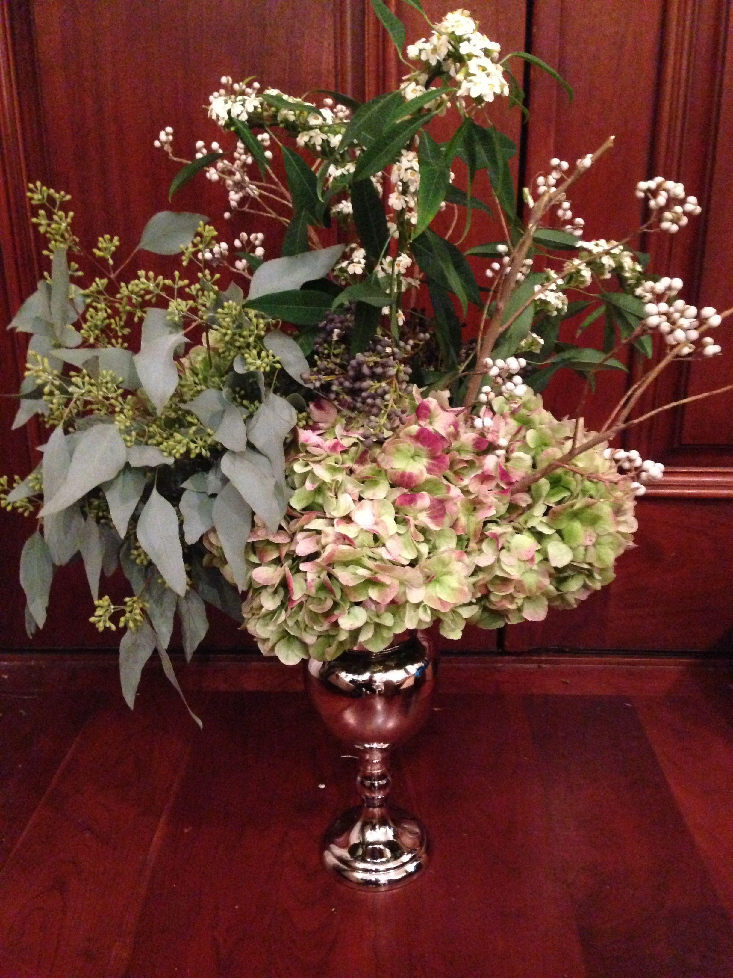 Simple Tall Centerpiece Of Hydrangea, Tallow Berry, Eucalyptus, Privet Berry