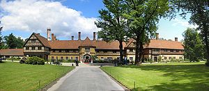 Schloss Cecilienhof is a palace in the northern part of the Neuer Garten park in Potsdam, Germany, close to the Jungfernsee lake.