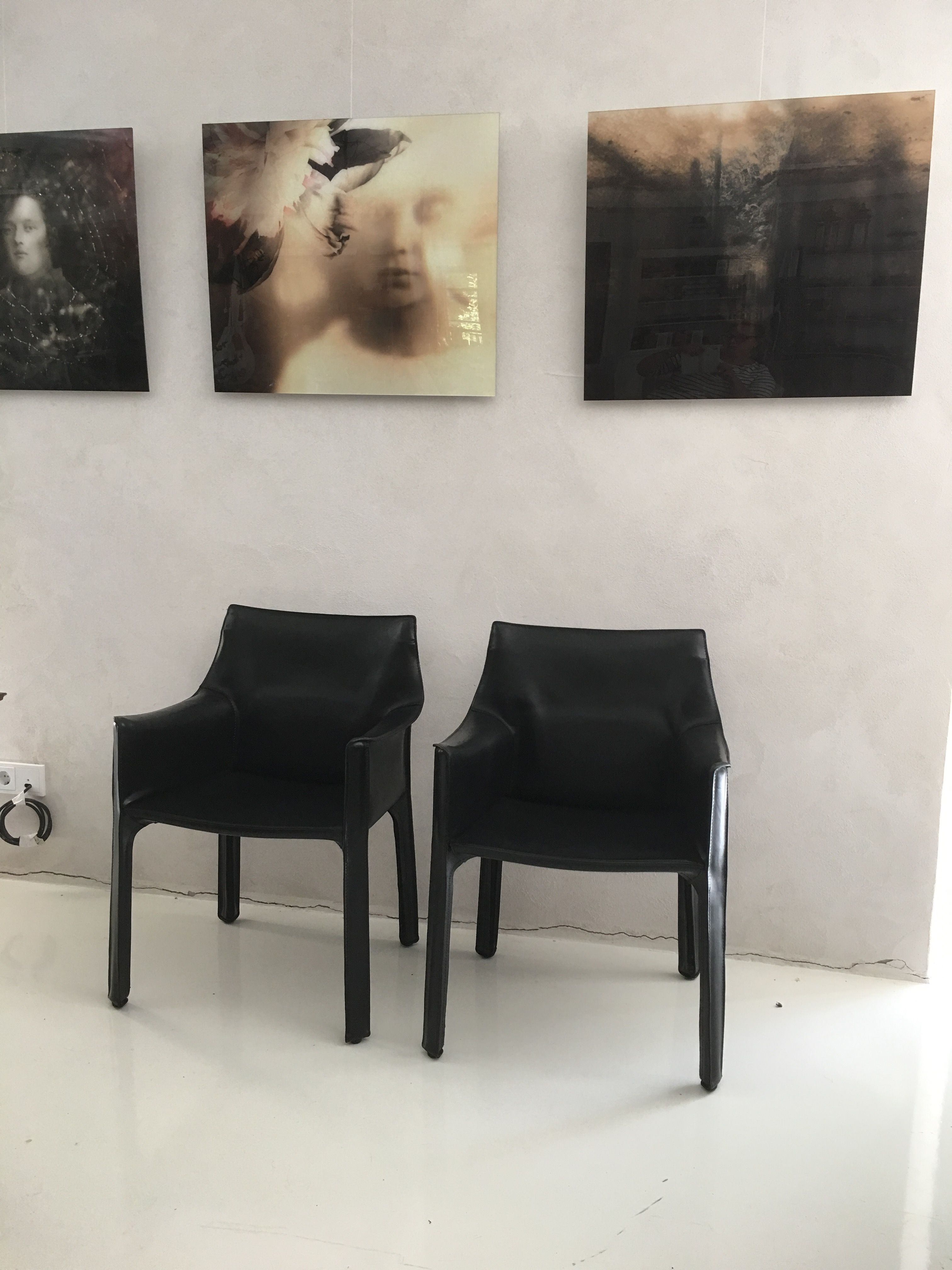 Mario Bellili's Cab chairs by Cassina reupholstered in Artemik