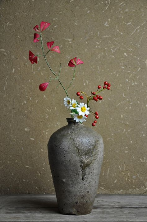 White Daisy Red Berries And Red Autumn Leaves On A Branch Ikebana