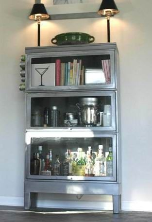 vintage steel tanker bookcase used in kitchen to store cook books and as liquor cabinet.