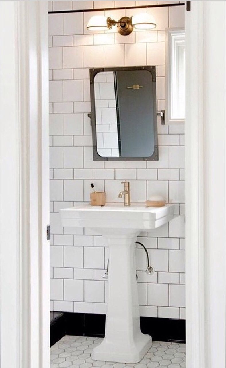 Black And White Bathroom Features A Restoration Hardware Industrial Rivet Flat  Mirror   Pivot Lit By A Vintage English Oval Double Sconce Placed Over A ...