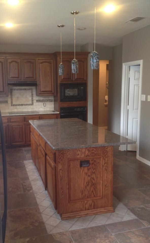Accent tile around this kitchen island modification provided ...