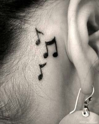 Notes music tattoo behind ear