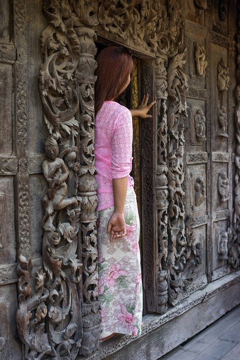 21 Photos That Reveal the True Beauty of Burma - Mandalay - A young woman stands in a doorway at Shwenandaw Kyaung (Golden Palace Temple). ... http://scotfin.com/ says, Like everywhere, the true beauty is the real people.