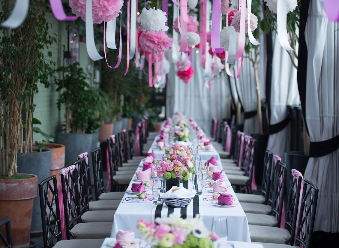 a garden inspired bridal shower in nyc at gramercy park hotel terrace with black and white stripes pink