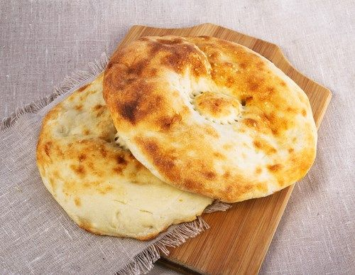 The types of #Turkishbread : #Bazlama is a single layered, flat, circular and leavened bread with a creamish yellow color. It is similar in taste to English #muffins. #bread #TurkishFlour