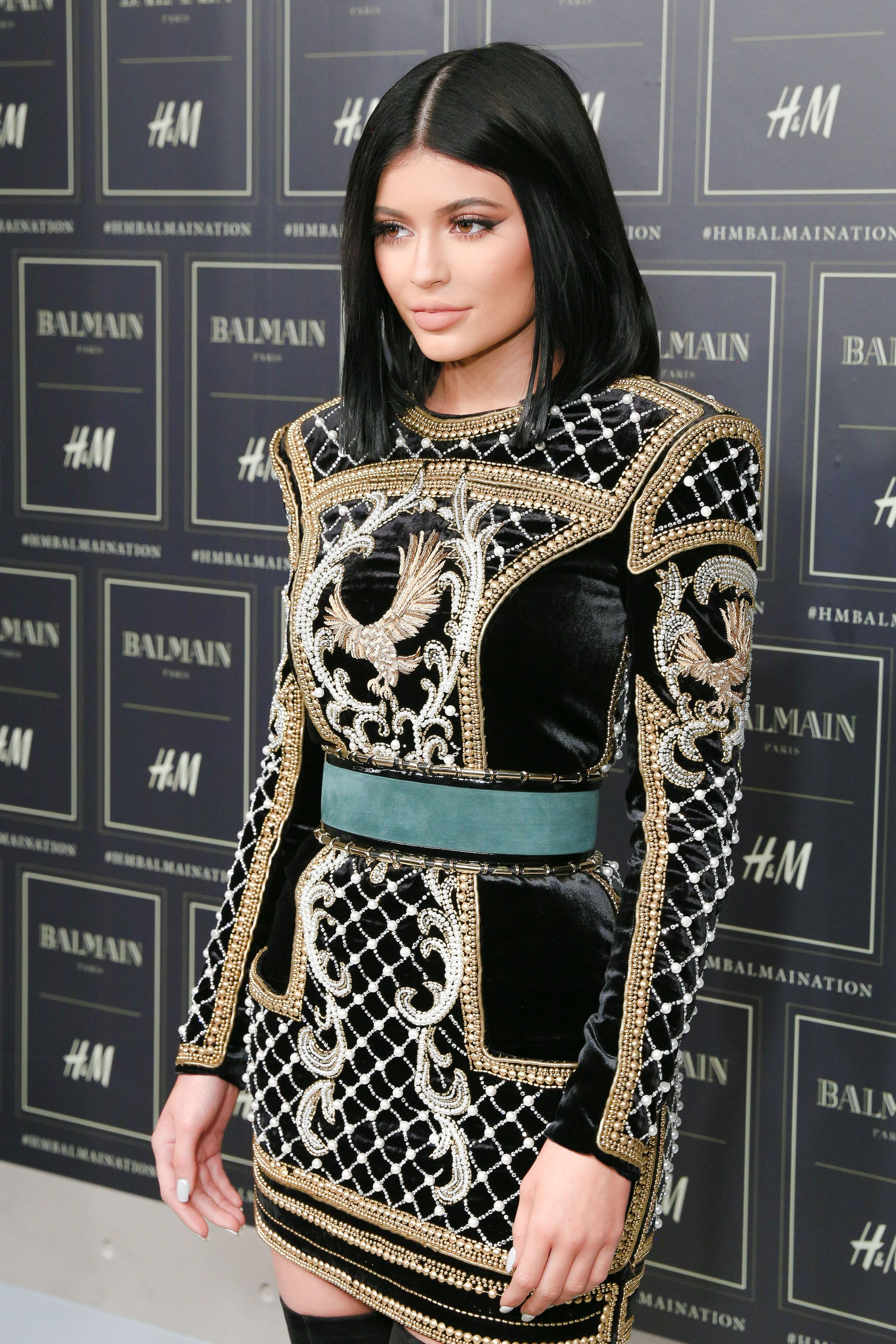 ea50f364 Kylie Jenner arrives on the red carpet at our Balmain x H&M show in an  embellished black mini dress from the Nov. 5th collection.