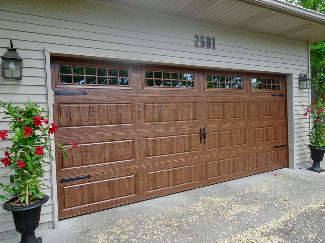 Amarr Hillcrest 3000 S Walnut Garage Door Installed By Augusta Garage Door Garage Doors Brick Exterior House Door Installation
