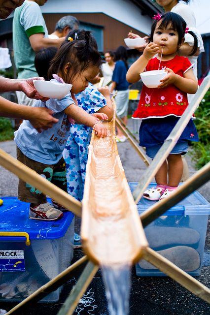 Kids eating nagashi somen by Martin Sedaghat