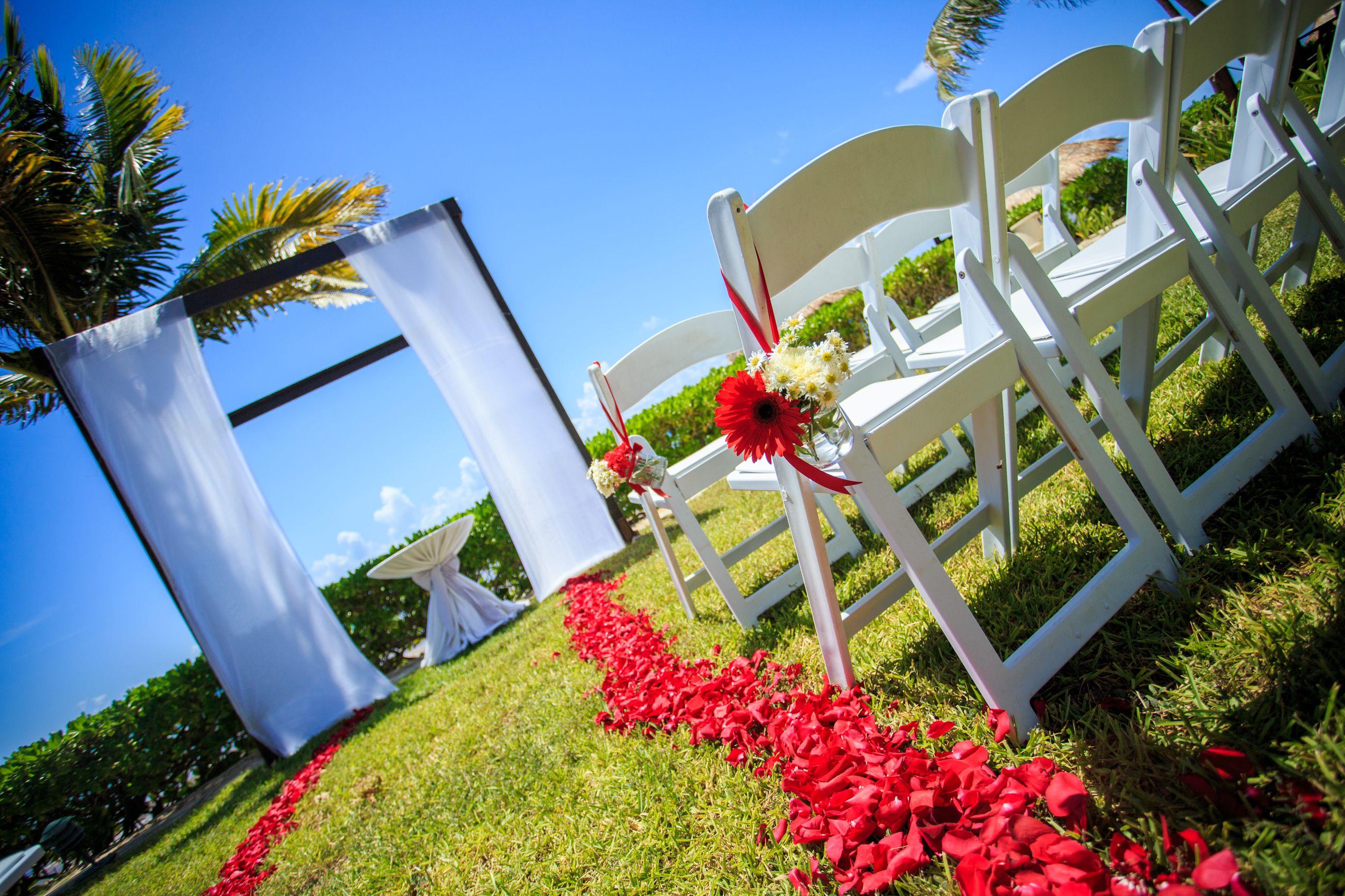 Take a walk down a gorgeous, rose petal-lined aisle at Secrets Capri Riviera Cancun!