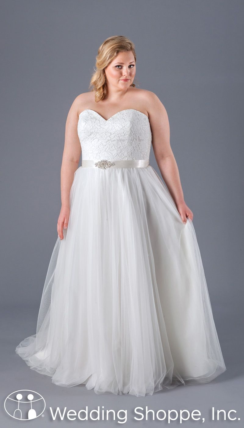 A romantic lace and tulle plus size bridal gown with a sweetheart