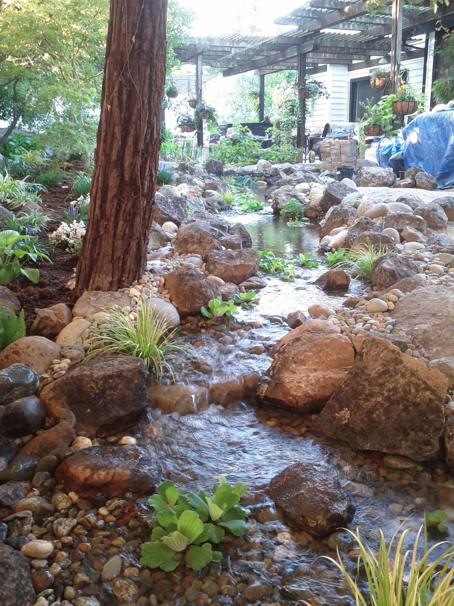 Ponds streams pondless waterfalls rockface for Backyard streams and waterfalls