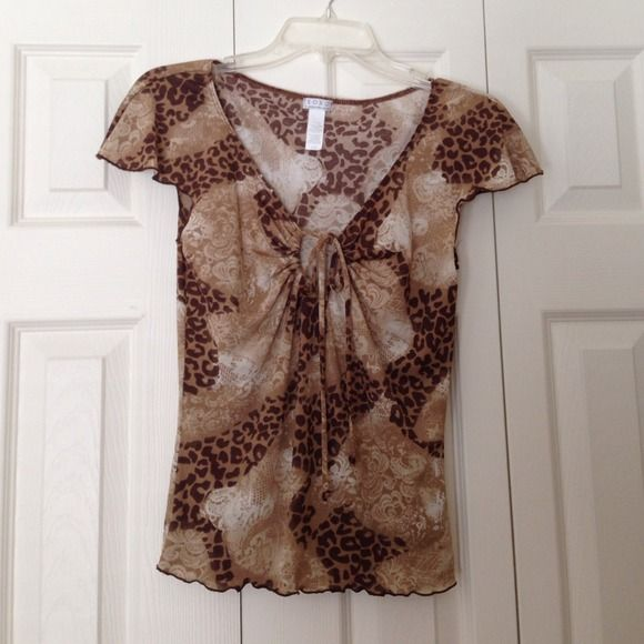 Xoxo Cap sleeve top Xoxo cap sleeve top. Cheetah and lace print with tie key hole detail as seen in second picture. Has been worn but in excellent condition. This top is a juniors size large XOXO Tops