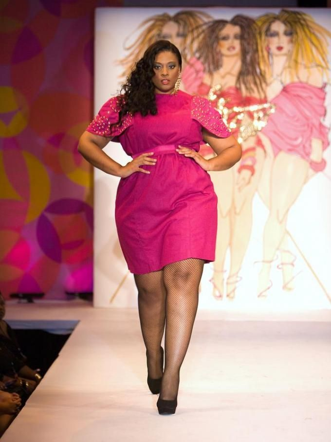 Pretty in pink and strutting her stuff on the catwalk ...