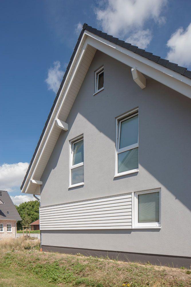 Photo of Fassade mit Holzverkleidung
