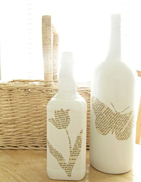 decorated glass bottles. Wine and glass bottles painted in opaque white are blank canvas for  charming shapes cut out of newspapers 35 DIY Bottles Bottle painting Blank Glass bottle