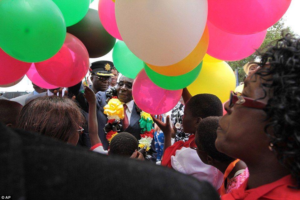 Celebrations:Zimbabwean President Robert Mugabe (centre) prepares to release 92 balloons ...