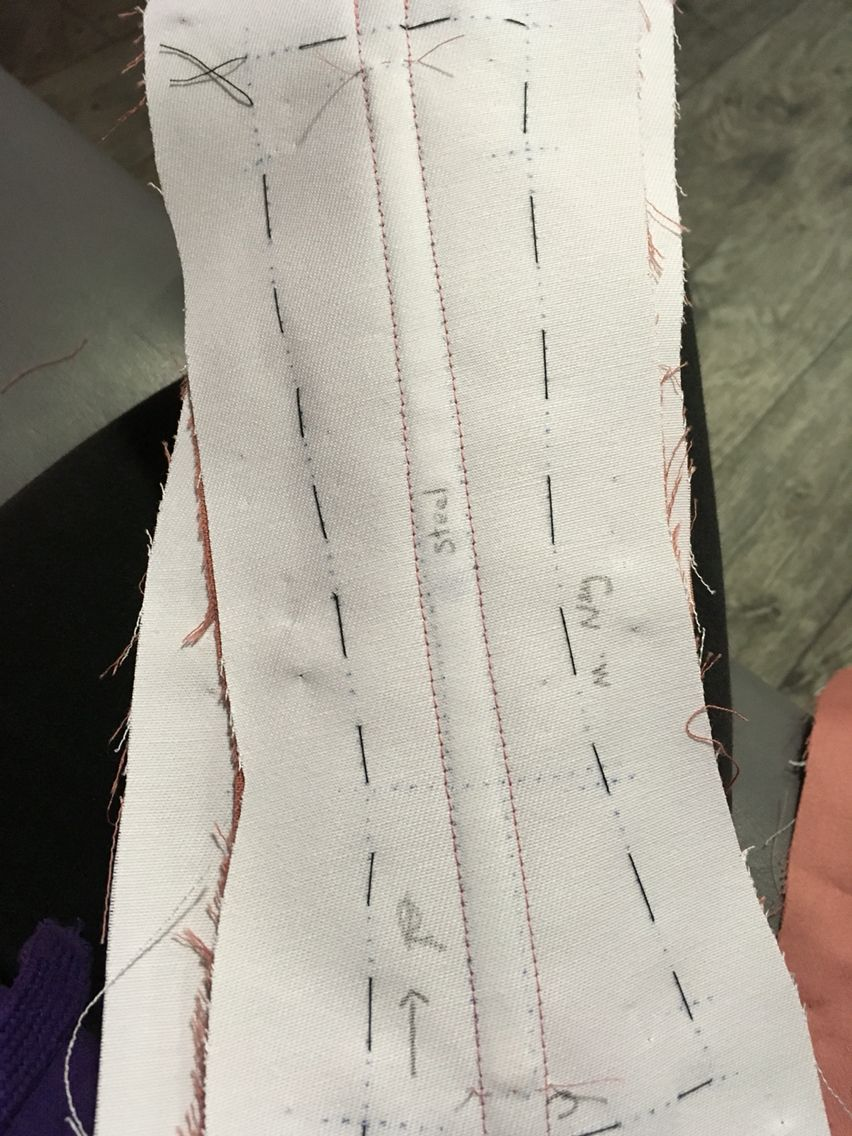 Add small tacking stitches above and below channels to stop the steels slipping out
